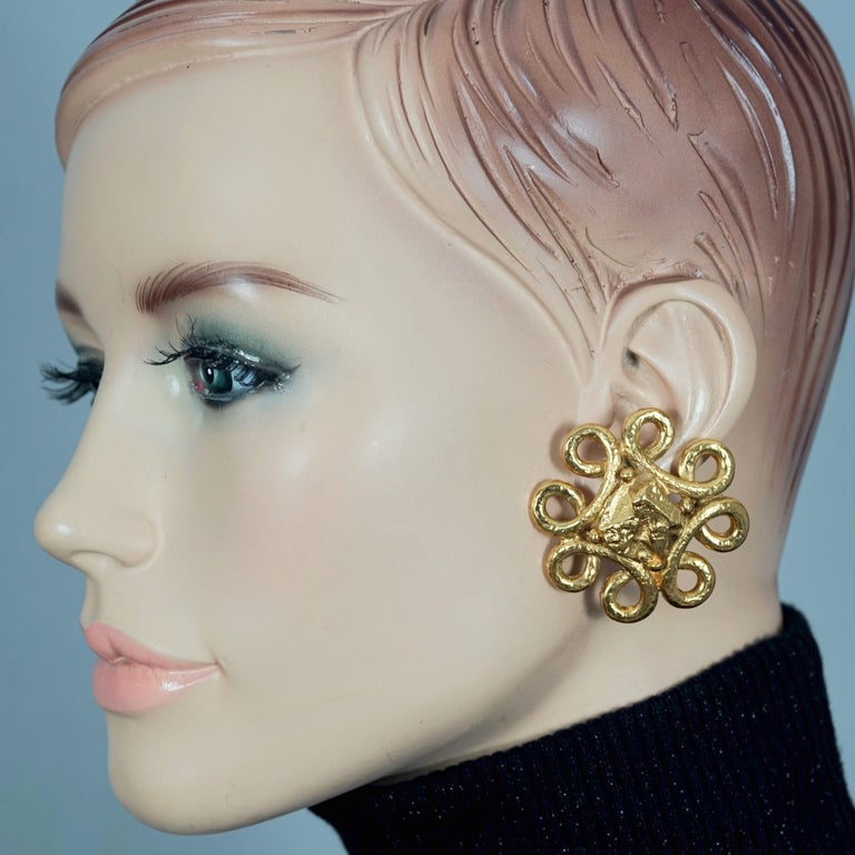 Vintage YVES SAINT LAURENT Ysl Nugget Loop Earrings  Measurements: Height: 1.73 inches (4.4 cm) Width: 1.73 inches (4.4 cm) Weight per Earring: 21 grams  Features: - 100% Authentic YVES SAINT LAURENT. - Chunky loop pattern earrings with textured