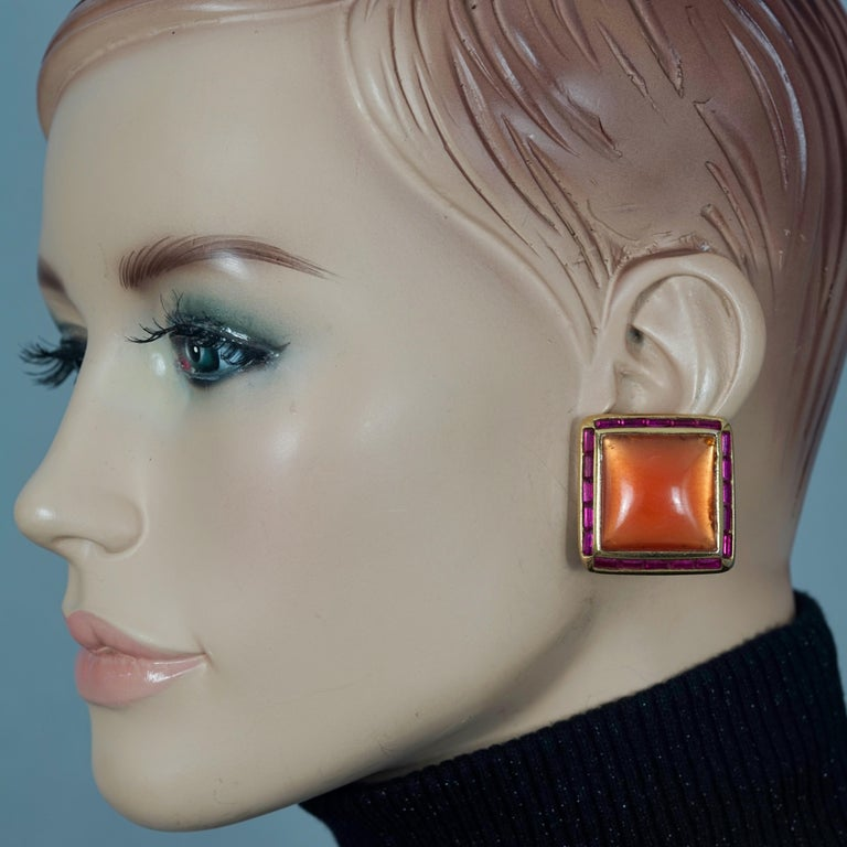 Vintage YVES SAINT LAURENT Ysl Orange Resin Rhinestone Earrings  Measurements: Height: 1.26 inches (3.2 cm) Width: 1.26 inches (3.2 cm) Weight per Earring: 15 grams  Features: - 100% Authentic YVES SAINT LAURENT. - Square and orange resin earrings
