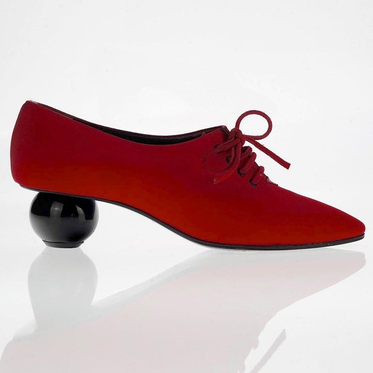 Vintage YVES SAINT LAURENT Ysl Red Ball Heel Pumps Lace Up Shoes  Measurements: Insole: 9 inches (23 cm) Heel: 1.57 inches (4 cm)  Features: - 100% Authentic YVES SAINT LAURENT. - Red lace up shoes in fabric. - Iconic ball heels in black. - Label