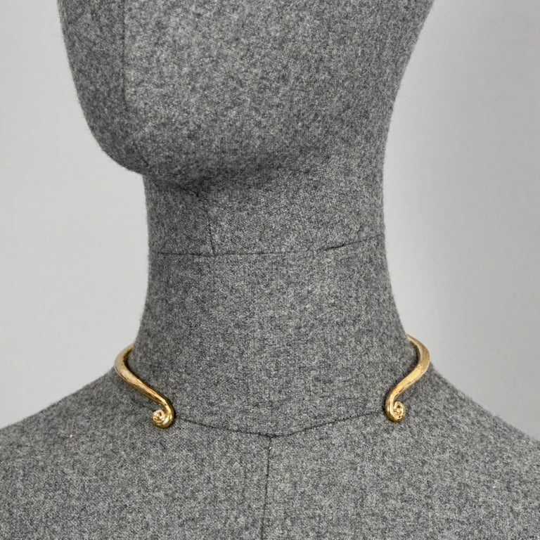 Vintage YVES SAINT LAURENT Ysl Rigid Spiral Choker Necklace  Measurements: Circumference: 13.58 inches (34.5 cm) including the opening Opening: 3.35 inches (8.5 cm)  Features: - 100% Authentic YVES SAINT LAURENT. - Skinny rigid choker with spiral