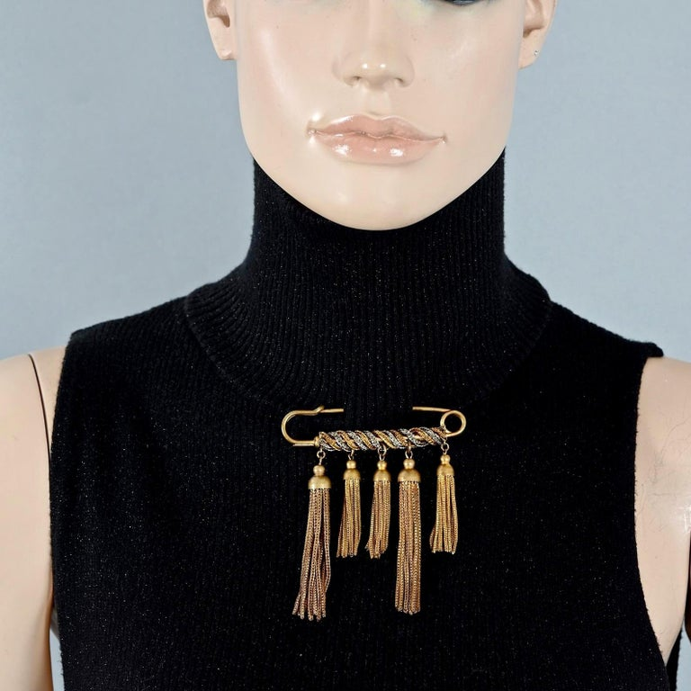 Vintage YVES SAINT LAURENT Ysl Safety Pin Tassel Brooch  Measurements: Height: 3.54 inches (9 cm) Width: 3.14 inches (8 cm)  Features: - 100% Authentic YVES SAINT LAURENT. - Safety pin brooch with chain tassel charms. - Gold and silver tone. -