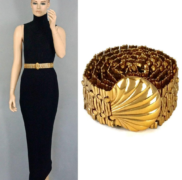 Vintage YVES SAINT LAURENT Ysl Shell Textured Metal Belt  Measurements: Height: 2.16 inches (5.5 cm) Length: 28.74 inches to 30.51 inches (73 cm to 77.5 cm)  Features: - 100% Authentic YVES SAINT LAURENT Rive Gauche. - Articulated textured metal