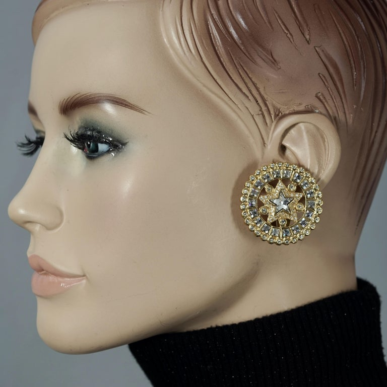 Vintage YVES SAINT LAURENT Ysl Star Rhinestone Medallion Disc Earrings  Measurements: Height: 1.50 inches (3.8 cm) Width: 1.50 inches (3.8 cm) Weight per Earring: 17 grams  Features: - 100% Authentic YVES SAINT LAURENT. - Star studded rhinestones