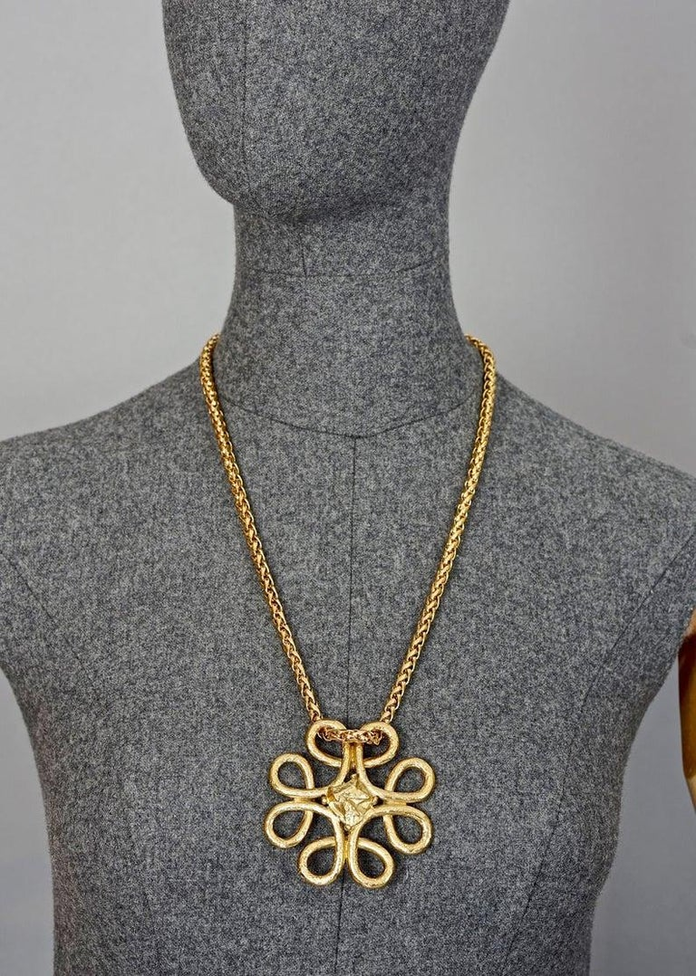 Vintage YVES SAINT LAURENT Ysl Swirl Nugget Necklace  Measurements: Height: 2.75 inches (7 cm) Width: 2.75 inches (7 cm) Wearable Length: 24.80 inches to 26.37 inches (63 cm to 67 cm)  Features: - 100% Authentic YVES SAINT LAURENT. - Chunky swirl