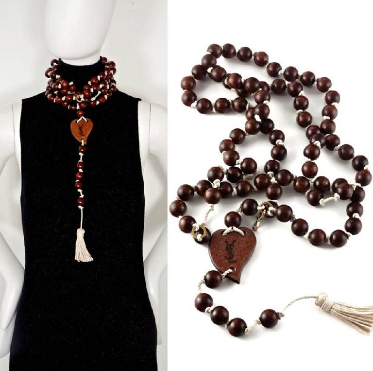 Vintage YVES SAINT LAURENT Ysl Wood Heart Rosary Tassel Belt Necklace  Measurements: Height of Heart: 2.51 inches (6.4 cm) Width of Heart: 1.85 inches (4.7 cm) Wearable Length: 69.29 inches (176cm) without the heart and tassel  Features: - 100%