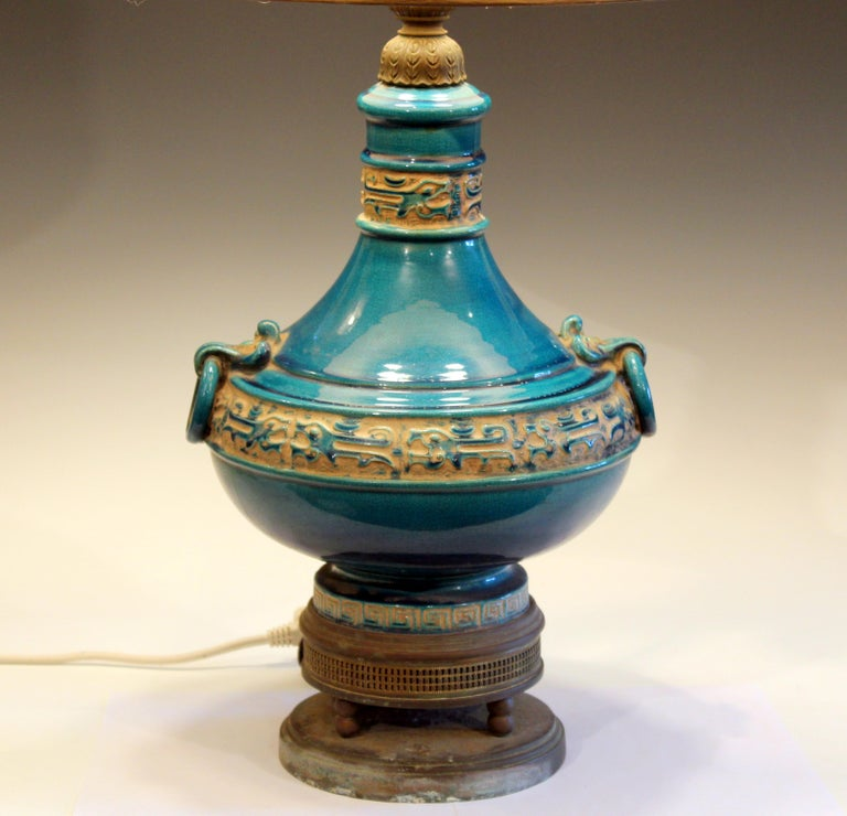 Zaccagnini pottery of Florence Italian lamp with ring handles and vibrant turquoise glaze, circa 1950s. Double socket cluster with new sockets. Corrosion to brass base, as shown. Measures: 28