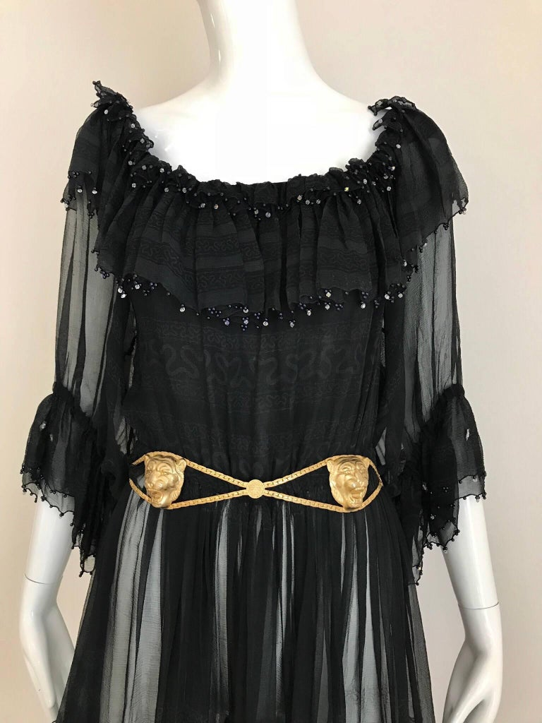 Late 70s Black Silk Zandra Rhodes off shoulder cocktail dress. elastic waist and elastic sleeve with ruffles. Belt is sold separately. Fit size 4/6/8 Small to medium