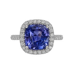 Violet-Blue Sapphire and Diamond Halo Ring