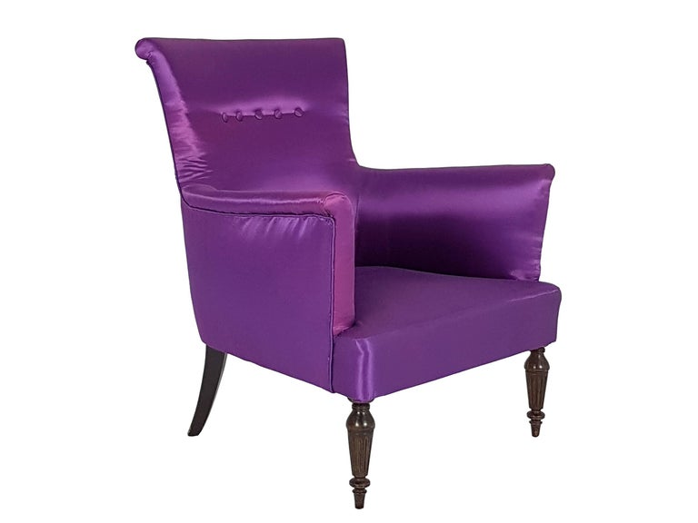 Fine and elegant pair of Italian armchairs with soft armrests and Classic-style legs. The armchairs remain in a perfect condition: the old fabric upholstery has been replaced with a changing violet one.