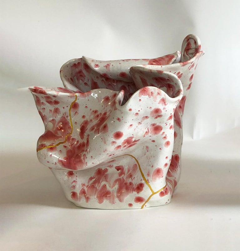 White visceral crawling glaze with 2 ear/ with a gold Kintsugi Japanese technique by Magda von Hanau From The Visceral sculpture Series Porcelain, clay sculpture with art glass glaze Dimensions: 33 H x 36 x 33 cm  One of a kind