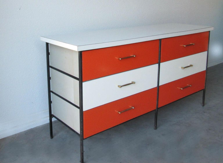 Chest of drawers by D.R. Bates and Jackson Gregory for Vista of California, 1950s. Wrought iron skeleton frame, multicolored drawer fronts in vivid orange and white, white laminate top and brass pulls. In very good original condition.