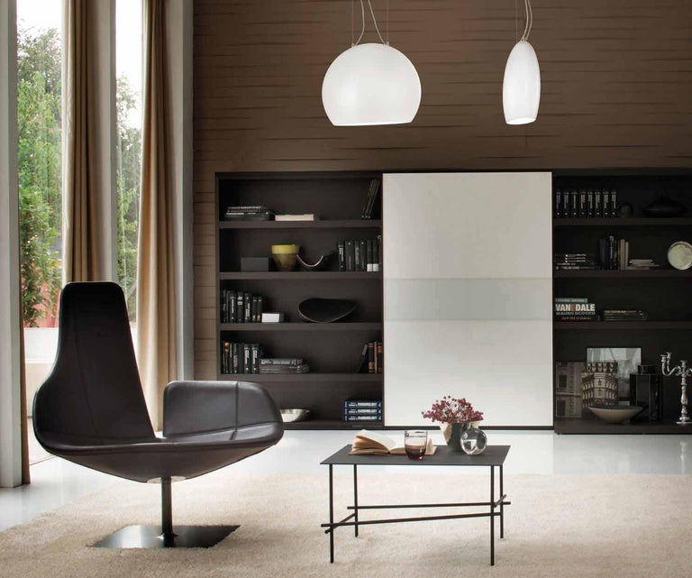 Pendant with a feminine character due to its soft lines and shape inspired by the moon cycle. LED dimmable lighting. Dimensions are in reference to the light fixture and not inclusive of the hanging length.