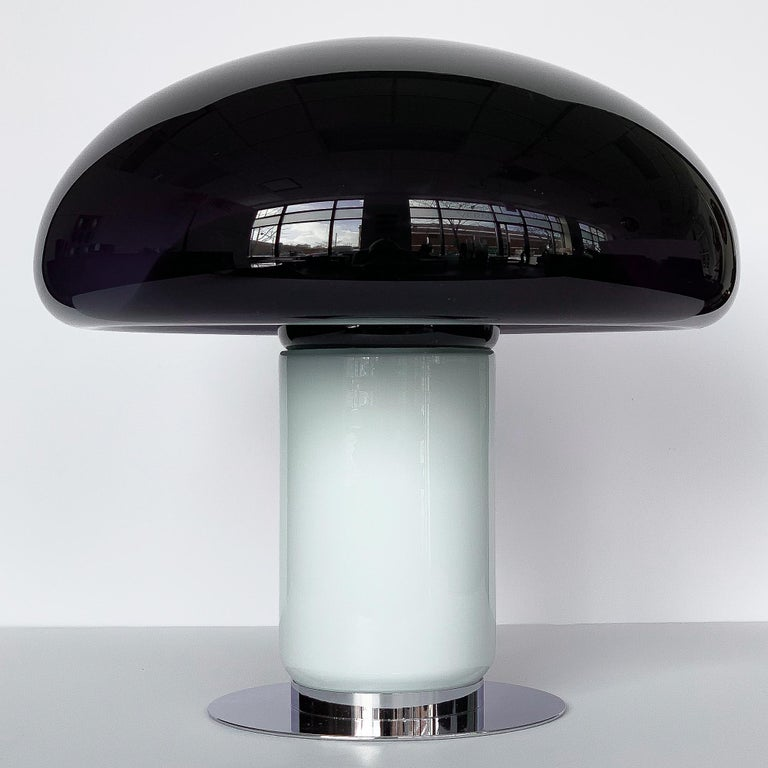 A Vistosi purple / amethyst mushroom shaped table lamp, circa 1960s Italy. Attributed to designer Michael Red. An almost black amethyst glass mushroom dome with fused white translucent stem. When the light is off the amethyst glass appears to be