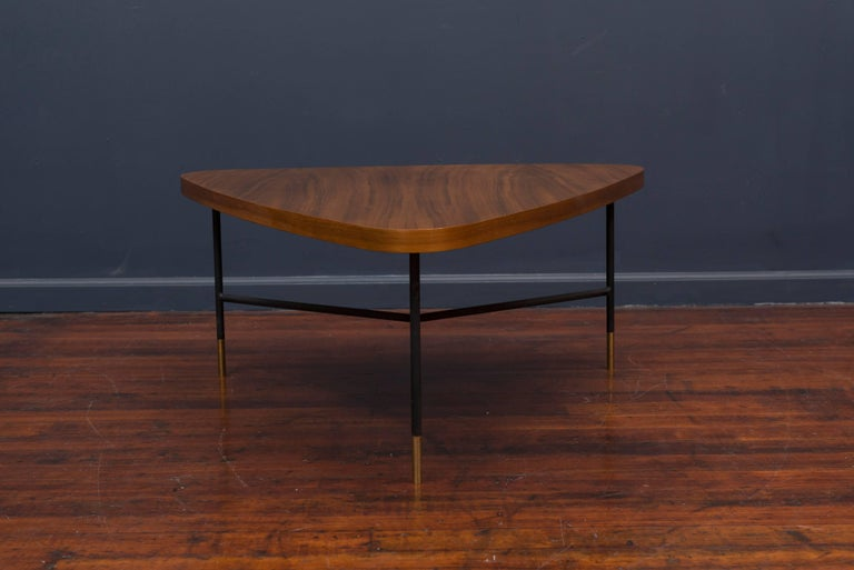 Gorgeous Italian solid walnut triangular coffee table designed by Vito Latis for Singer & Son's, Italy. Excellent original condition showing only a minor scuff or indentation on the wood, solid steel legs with brass feet, labelled.