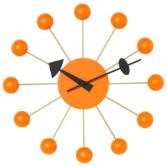 Vitra Ball Wall Clock in Orange with Black Hand by George Nelson