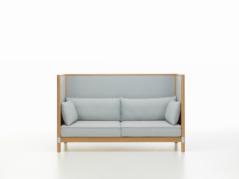These products are only available in the United States.  The clean-lined aesthetic of Cyl Sofa, with its smooth planes, orthogonal frame and cylindrical supports, is emphasized by components made of solid wood. This makes it an ideal piece for