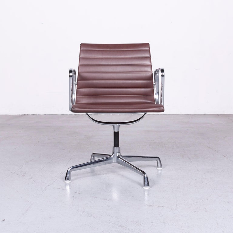 We bring to you a Vitra EA 108 designer leather chair brown chrome.