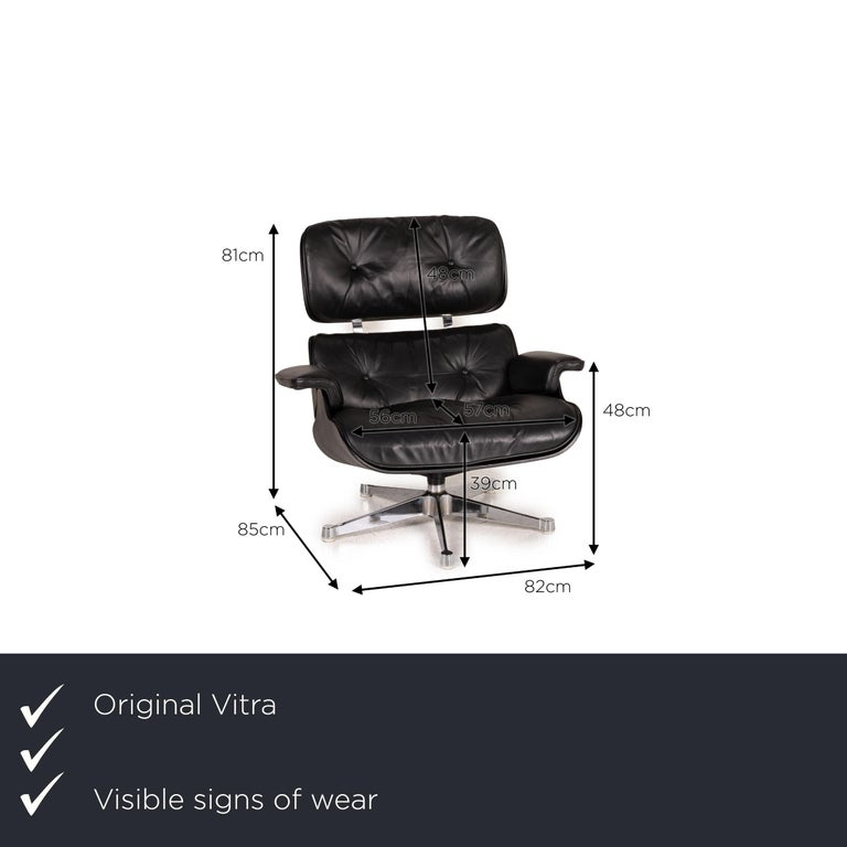 We present to you a Vitra Eameas lounge leather armchair black including ottoman.  SKU: #16349-c1     Product measurements in centimeters:     depth: 85  width: 82  height: 81  seat height: 39  rest height: 48  seat depth: 57  seat