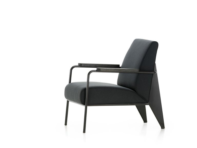 Vitra Fauteuil de Salon armchair in black by Jean Prouvé. Developed by Jean Prouvé, the Fauteuil de Salon is a typical example of the distinctive structural aesthetic of his designs. The armchair's understated character suits a wide variety of