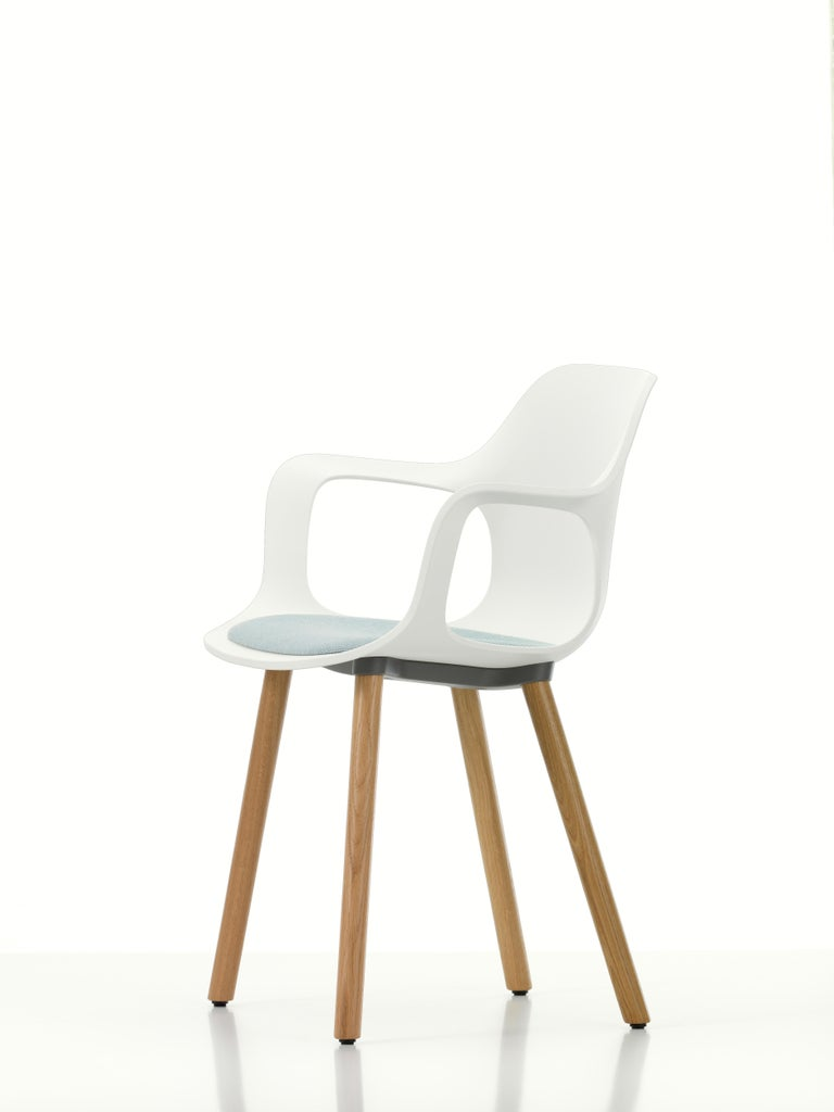 These products are only available in the United States.  Vitra HAL armchair wood with seat upholstery in white by Jasper Morrison.  Materials: Seat shell: Dyed-through polypropylene, with seat cushion (screwed to the seat shell). Base: Non-stackable