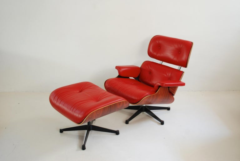 Vitra lounge chair in red rosso semi aniline leather.