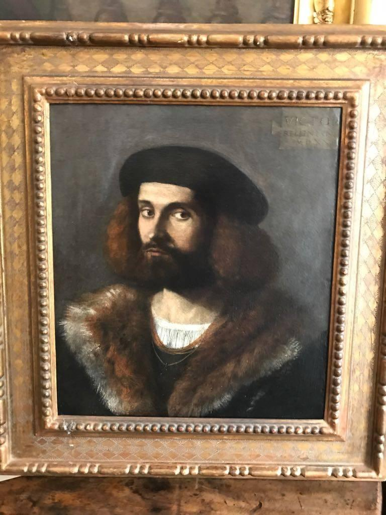 Vittore Belliniano (c 1456 -‐ 1529)  Portrait of a Young Bearded Man, wearing a Black cap and Fur-lined cloak signed and dated 1521  oil on canvas 21 x 18 ½ in (53.3 x 46.9 cm)  Provenance: -Von Foerster, Heidelberg -A. Wertheim Auction, Berlin,
