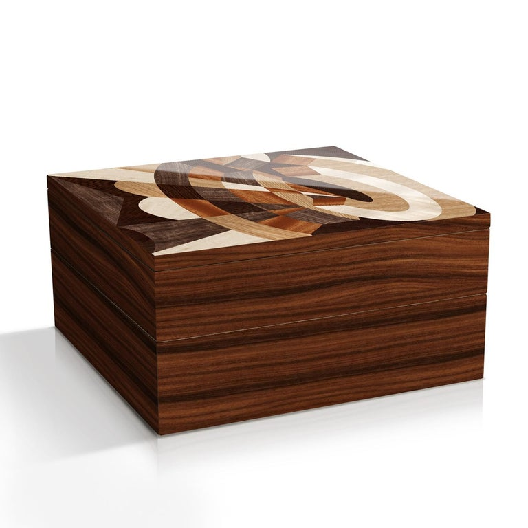 An absolute work of art, this refined piece can be used as a jewelry box, a keepsake for treasured mementos, or a purely decorative piece to showcase atop a bedroom dresser or living room console. This sophisticated box boasts a rectangular shape
