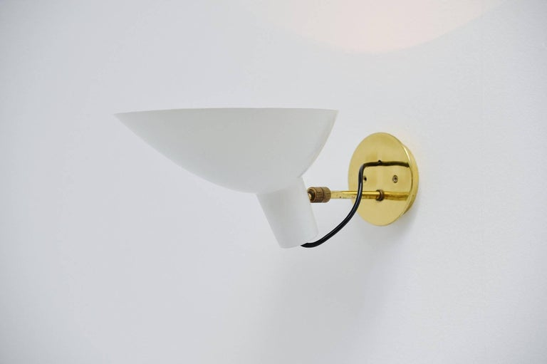 Very nice pair of sconces designed by Vittoriano Vigano supervised by Gino Sarfatti, this is model 2 manufactured by Arteluce Milano, Italy 1950. This is for a pair of also called 'visor'sconces in very good original condition. These sconces have