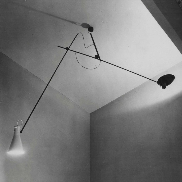 Vittoriano Viganò 'VV Suspension' lamp in black and white for Astep. Viganò was the art director of Arteluce, the company founded by his creative partner Gino Sarfatti, and the visor was one of his most celebrated design series. Designed in 1951