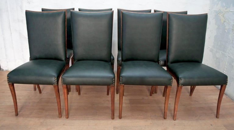 These eight dining chairs were designed by the famous Italian design Vittorio Dassi, Italia, 1950. The chairs have been partially restored, the upholstery has been redone in green eco-leather, as it was originally.