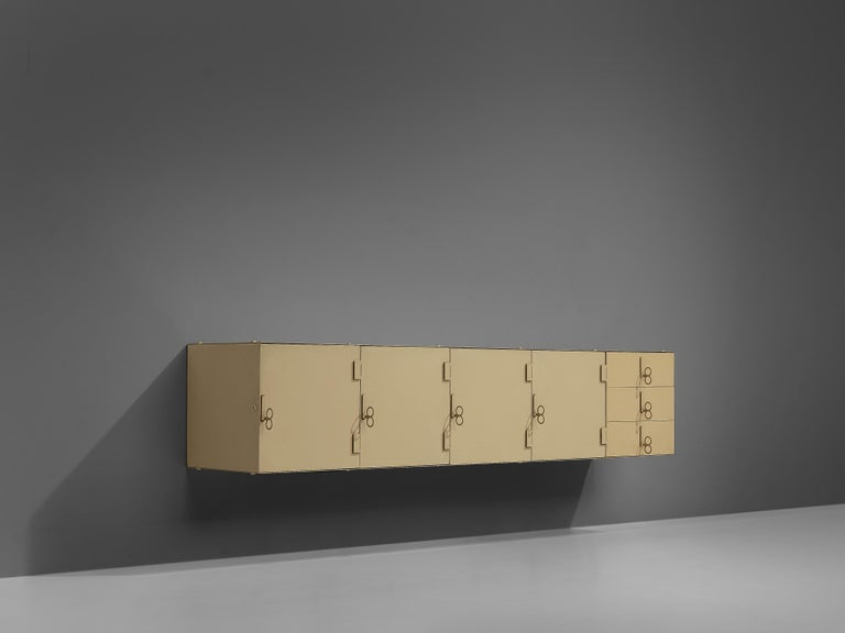 Vittorio Introini, Saporiti, wall-mounted credenza, beige colored lacquered metal, Italy, 1960s  Exceptional sideboard designed by Vittorio Introini for Saporiti in the 1960s. The rationalist metal sideboard has a clear and functionalist design