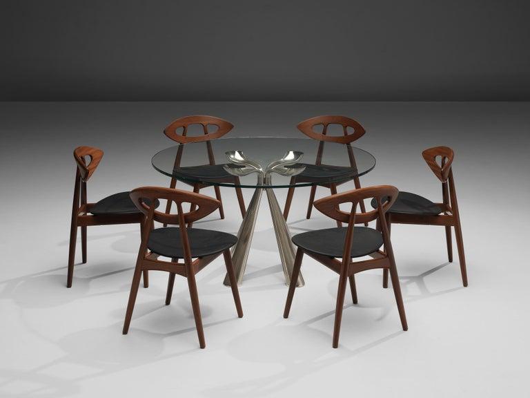 Ejvind A. Johansson for Ivan Gern Møbelfabrik, set of six dining chairs model 84 'Eye,' teak, black leather, Denmark, design 1961, production 1970s Wonderful and exclusive set of six 'Eye' chairs by Danish designer Ejvind Johansson. Characteristic