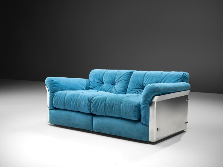 Vittorio Introini for Saporiti, two-seat sofa, blue suede fabric and chrome, Italy, 1969.  This settee is designed by Vittorio Introini and produced by Saporiti in chrome and sea blue upholstery. The piece features a steel shell with thick,