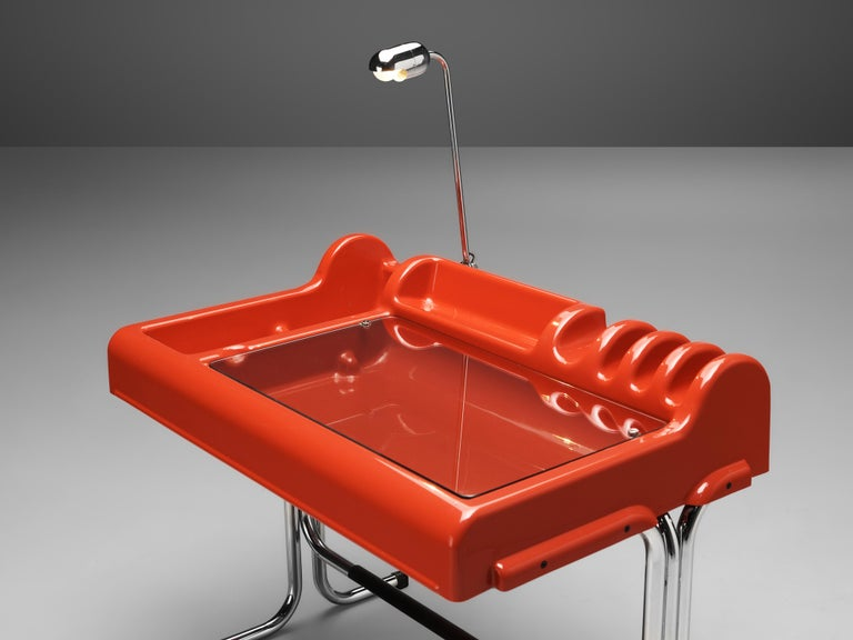 Vittorio Parigi and Nani Prina, 'Orix' desk with lamp, red polyester, chromed steel, glass, leatherette, Italy, 1970.  Postmodern 'Orix' writing desk with chair designed by Vittorio Parigi and Nani Prina. The set is executed in eye-catching red