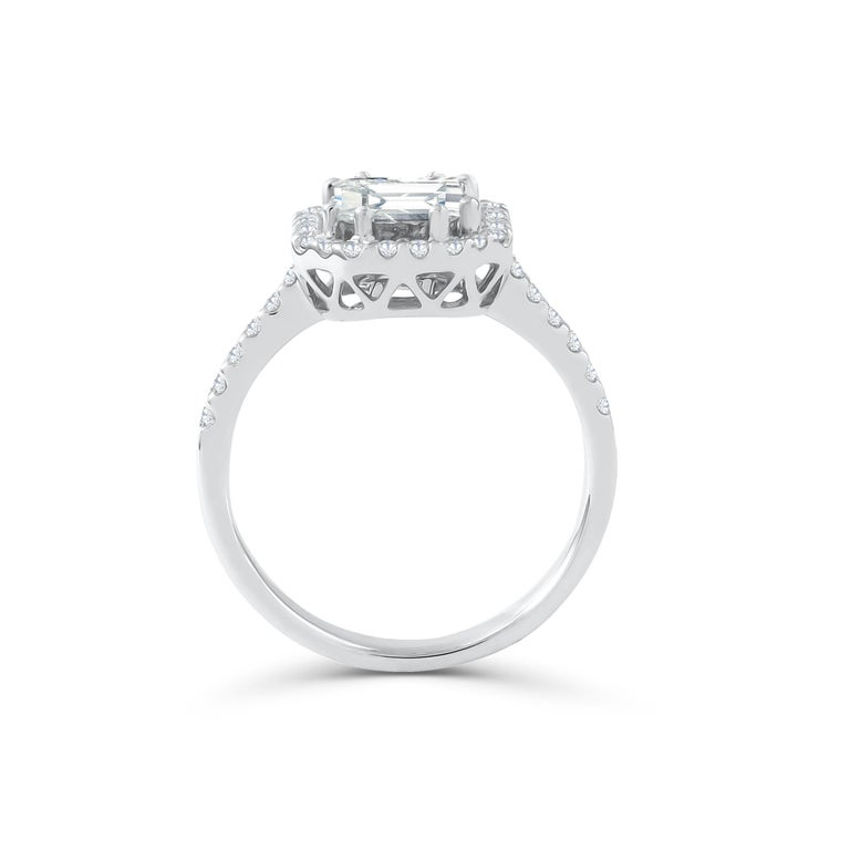 This diamond ring has a Emerald shape Illusion (Pie Cut) to create the look of a 2.50 carat single Emerald cut stone surrounded beautifully with brilliant round diamonds, Handcrafted in 18 kt white gold. This Ring will add a touch of sophistication