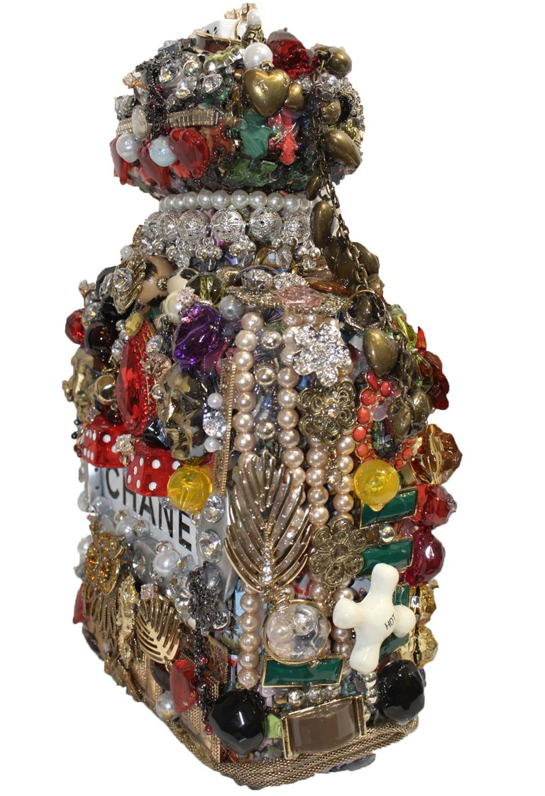 Joe Baby's Viva Las Vegas themed Chanel bottle incorporates all the things that might bring you luck!  Find your lucky charms... It's all just a roll of the dice.  Diamonds, pearls, crystals, flowers or owls every little space is filled with a mini
