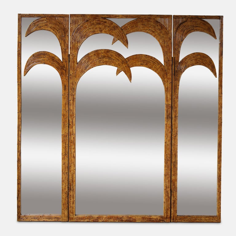 Vivai del Sud bamboo mirrored screen from the 'Parma' series, Italy, 1970s. This exquisite screen consists of bamboo palm tree motif inlay on a 3-panel mirrored screen. These panels are expertly constructed from a padding over a wooden structure. On
