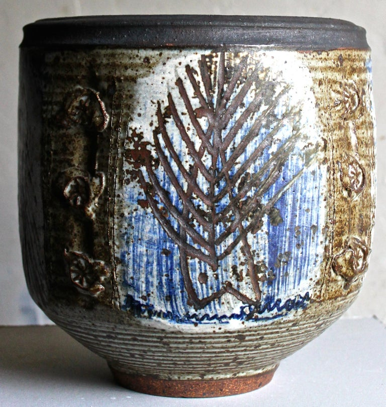 Beautiful large bowl with scraffito and applied decoration in tans and blue.