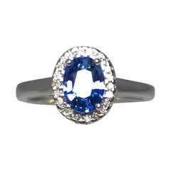 Vivid 1.22 Carat Ceylon Blue Sapphire and Diamond 18 Karat White Gold Halo Ring