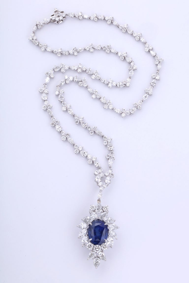 A beautifully designed piece.  Certified 11.49 carat Vivid Blue Ceylon Sapphire set with 22.70 carats of white round, pear and marquise cut diamonds.   The sapphire pendant portion can be removed and the diamond chain can be worn on its own.   Set