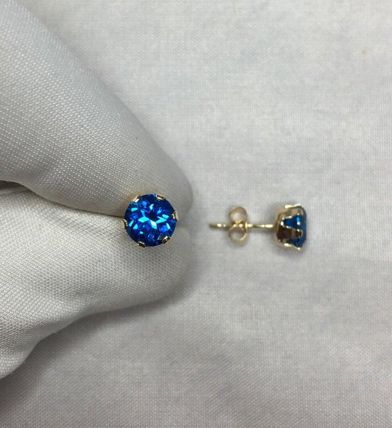 Vivid Blue Topaz 2 Carat Yellow Gold Round Brilliant Diamond Cut Earring Studs For Sale 1