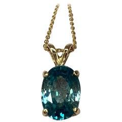 Vivid Blue Zircon 3.62 Carat Oval Cut Yellow Gold Solitaire Pendant Necklace