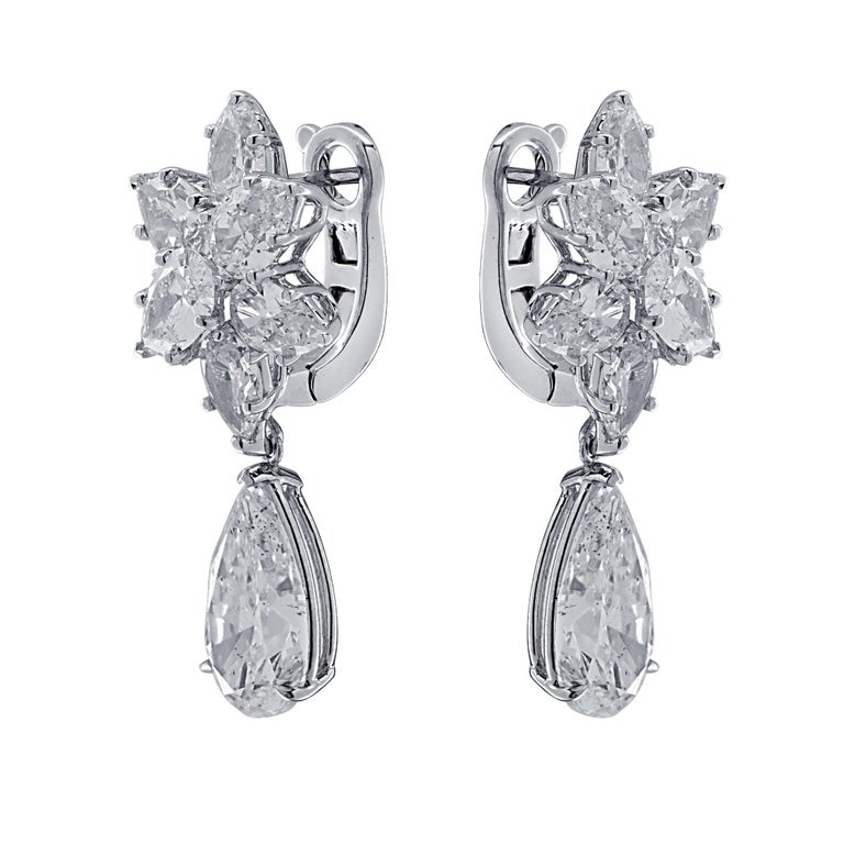 Sensational Vivid Diamonds day and night diamond earrings, finely crafted by hand in 18 karat white gold, showcasing a spectacular GIA certified pear shape diamond weighing 3.04 carats, G color, SI2 clarity, and a spectacular EGLNY Certified pear