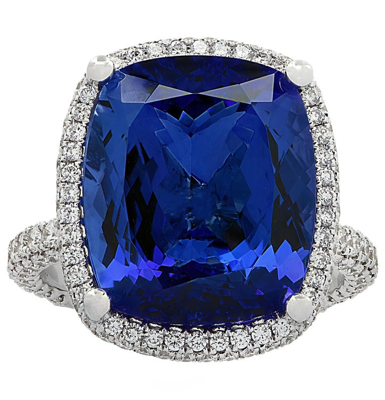 Gorgeous Vivid Diamonds ring crafted in 18 karat white gold, showcasing an exquisite cushion cut Tanzanite weighing 10.66 carats, adorned with 206 round brilliant cut diamonds weighing 1.38 carats total, G color, VS clarity. The magnificent blue