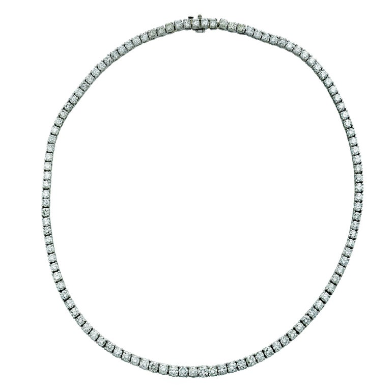 Exquisite Vivid Diamonds Straight Line diamond tennis necklace crafted in 18 karat White Gold, showcasing 106 round brilliant cut diamonds weighing 14.61 carats, E-F color, VS Clarity. Each diamond was carefully selected, perfectly matched and set