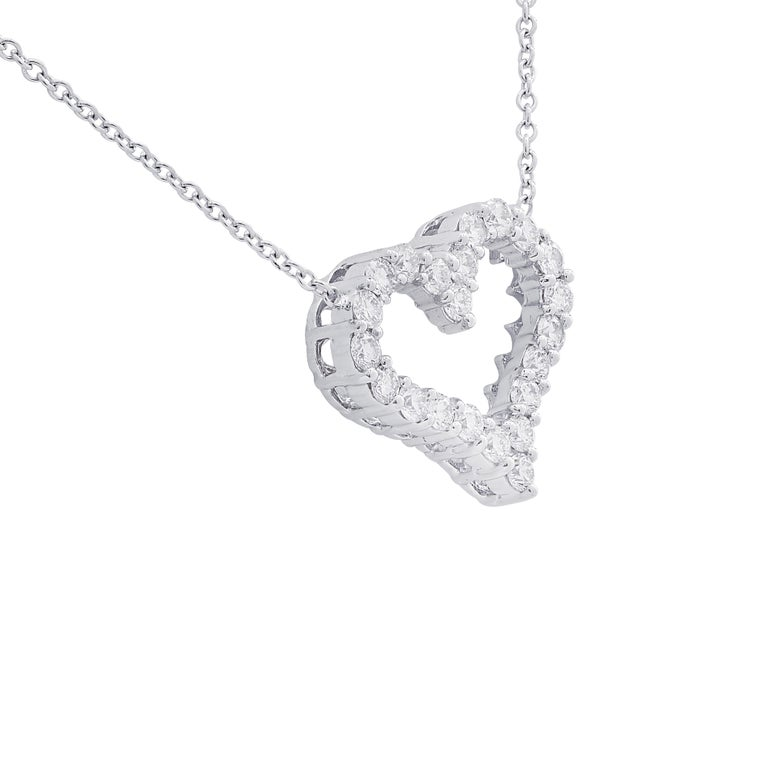 Enchanting Vivid Diamonds heart necklace crafted in 18 karat white gold featuring 22 round brilliant cut diamonds weighing approximately 1.5 carats total, G color, VS-SI clarity arranged in a delightful open heart design. This stunning necklace