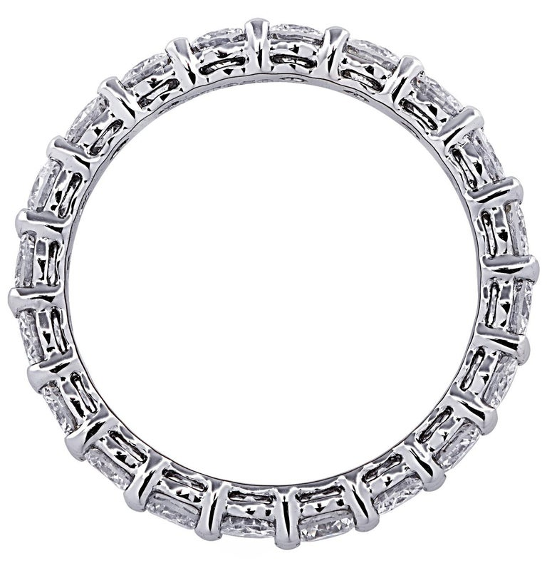 Exquisite Vivid Diamonds eternity band crafted in 18 karat white gold, showcasing 20 stunning round brilliant cut diamonds weighing 2.16 carats total, G color, VS-SI clarity. Each diamond is carefully selected, perfectly matched and set in a