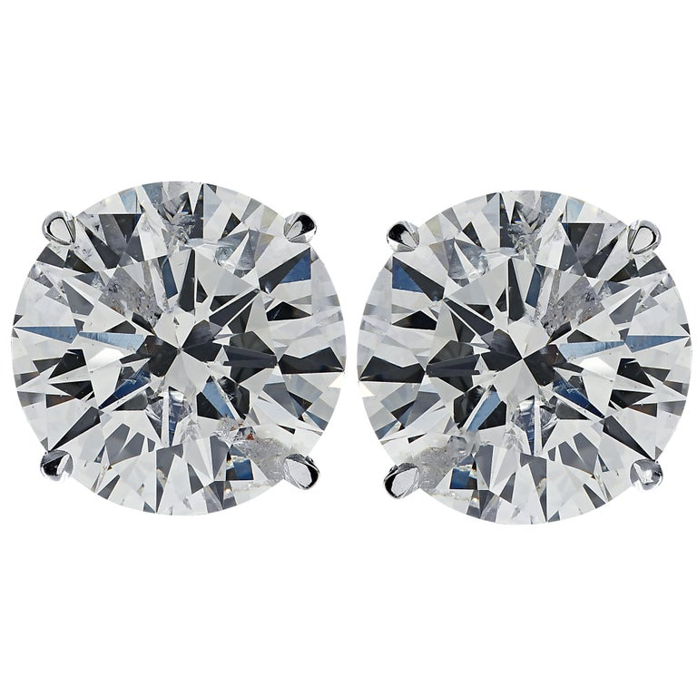 Stunning Vivid Diamonds solitaire stud earrings crafted in 18 karat white gold, showcasing 2 round brilliant cut diamonds weighing 2.56 carats total, G-H color SI clarity. These diamonds were carefully selected and perfectly matched to create these