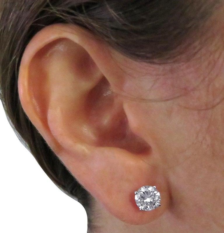 Round Cut Vivid Diamonds 2.56 Carat Diamond Solitaire Stud Earrings For Sale