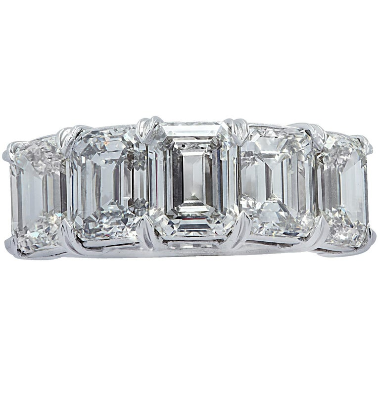 Stunning Vivid Diamonds five stone wedding band crafted in platinum, showcasing 5 spectacular emerald cut diamonds weighing 6.02 carats total, J-K color, VS clarity. Each diamond was carefully selected, perfectly matched and set in a seamless sea of
